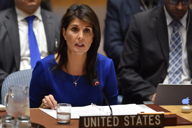 US Ambassador to the UN Nikki Haley speaks during a UN Security Council meeting, at the United Nations Headquarters in New York, on April 14, 2018. The UN Security Council on Saturday opened a meeting at Russia's request to discuss military strikes carried out by the United States, France and Britain on Syria in response to a suspected chemical weapons attack. Russia circulated a draft resolution calling for condemnation of the military action, but Britain's ambassador said the strikes were 'both right and legal' to alleviate humanitarian suffering in Syria.  / AFP PHOTO / HECTOR RETAMAL        (Photo credit should read HECTOR RETAMAL/AFP/Getty Images)