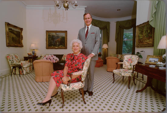 Slide 10 of 28: U.S. Vice President George H.W. Bush and Mrs. Barbara Bush at the Vice President's residence circa 1983 in Washington.