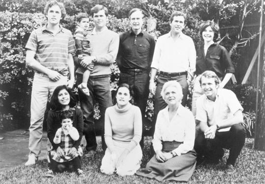 Slide 7 of 28: (Original Caption) Bush Family Photo. Top, Left to right: Marvin, 22; George, 3; Jeb, 26; George; George W., 33; George's wife, Laura. Bottom, left to right: Jeb's wife, Columba; Noelle, 2; Dorothy, 20; Barbara; Neil, 24.