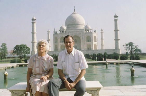 Slide 9 of 28: U.S. Vice President George H. W. Bush, right, and his wife Barbara Bush pose in front of the Taj Mahal, the 17th century monument to love was built by a Mughal Emperor Sahajahan in memory of his beloved queen who bore 14 children, Saturday, May 13, 1984, Agra, India.