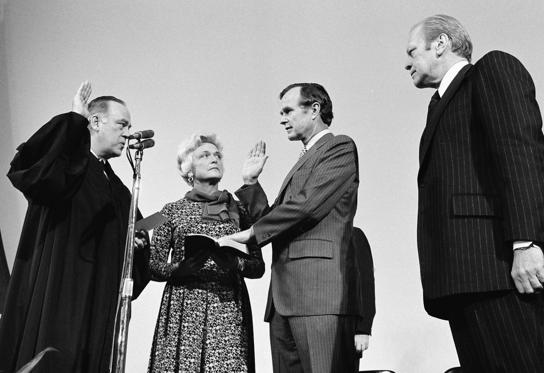 Slide 6 of 28: George Bush is sworn in as new director of the Central Intelligence Agency by Supreme Court Associate Justice Potter Stewart, left, as Mrs Barbara Bush and President Gerald Ford, at right, look on at CIA headquarters in Langley, Va., January 30, 1976.
