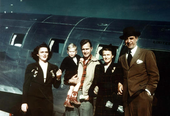 Slide 2 of 28: George W. Bush with his mother Barbara Bush, father, George Bush, and grandparents, Prescott and Dorothy Bush in Midland, Texas.