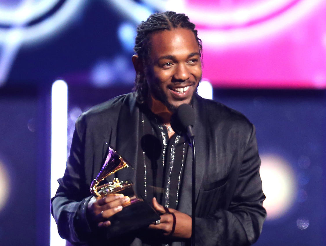 """FILE - In this Jan. 28, 2018 file photo, rapper Kendrick Lamar accepts the award for best rap album for """"Damn"""" at the 60th annual Grammy Awards in New York. On Monday, April 16, 2018, Lamar won the Pulitzer Prize for music for his album """"Damn."""" (Photo by Matt Sayles/Invision/AP, File)"""