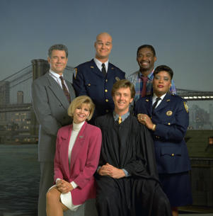 Pictured: (l-r) John Larroquette as Dan Fielding, Markie Post as Christine Sullivan, Richard Moll as Nostradamus 'Bull' Shannon, Harry Anderson as Judge Harry T. Stone, Charles Robinson as Mac Robinson, Marsha Warfield as Rosalind 'Roz' Russell.
