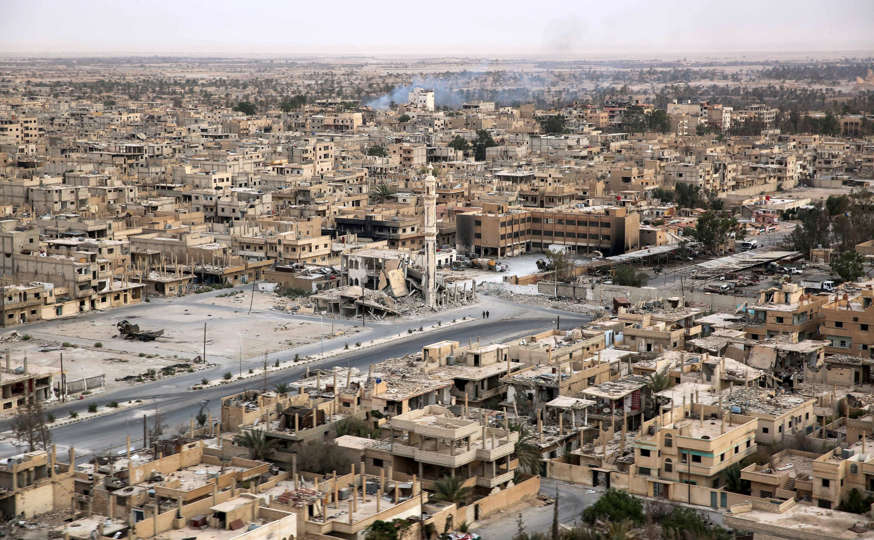 A picture taken from a helicopter during a press tour provided by the Russian Armed Forces on September 15, 2017 shows an aerial view of the modern city of Palmyra, in Syria's central province of Homs.