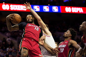 PHILADELPHIA, PA - APRIL 16: James Johnson #16 of the Miami Heat grabs a rebound against Dario Saric #9 of the Philadelphia 76ers in the second quarter during Game Two of the first round of the 2018 NBA Playoff at Wells Fargo Center on April 16, 2018 in Philadelphia, Pennsylvania. NOTE TO USER: User expressly acknowledges and agrees that, by downloading and or using this photograph, User is consenting to the terms and conditions of the Getty Images License Agreement. (Photo by Mitchell Leff/Getty Images)