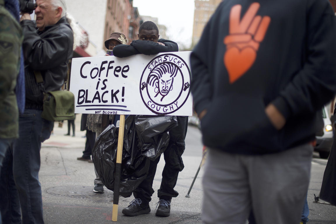 PHILADELPHIA, PA - APRIL 15:  Protestor Jack Willis, 26, (C) demonstrates outside a Starbucks on April 15, 2018 in Philadelphia, Pennsylvania.  Police arrested two black men who were waiting inside the Center City Starbucks which prompted an apology from the company's CEO.  (Photo by Mark Makela/Getty Images)