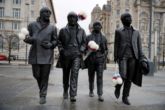"Slide 1 de 39: A statue of The Beatles sports ""tickling sticks"", comedian Ken Dodd's quintessential prop, ahead of Dodd's funeral in his home town of Liverpool, Britain, March 28, 2018."