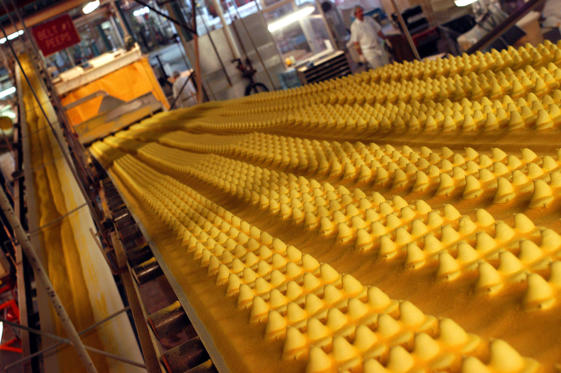Freshly pressed Marshmallow Peeps are seen from behind as they move along the production line at Just Born March 12, 2004 in Bethlehem, Pennsylvania.