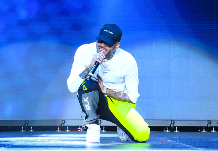 Singer Chris Brown performs onstage at 3rd Annual V-103 Winterfest Concert at Philips Arena on December 16, 2017 in Atlanta, Georgia.