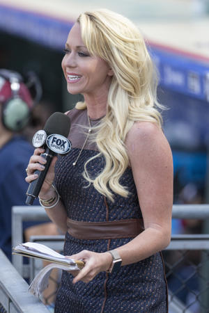 Fox Sports reporter Kelsey Wingert in action during the seventh inning of a baseball game between the Atlanta Braves and Philadelphia Phillies, Sunday, Sept. 4, 2016, in Philadelphia.