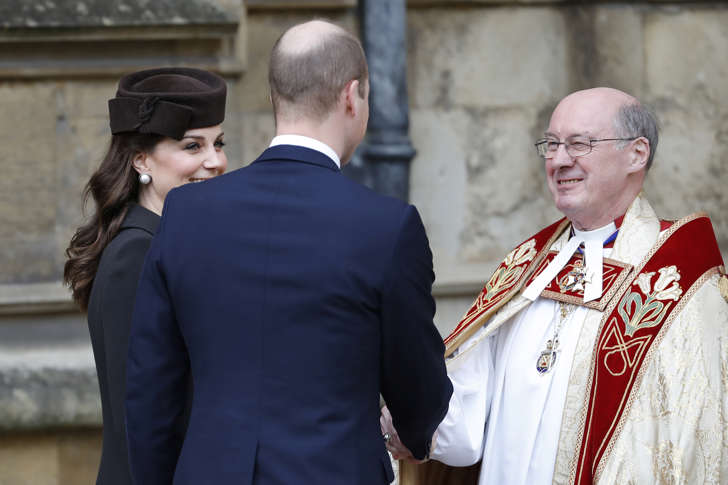 Britain's Prince William and Catherine, Duchess of Cambridge, are greeted by the Dean of Windsor, David Conner, as they arrive for the annual Easter Sunday service at St George's Chapel at Windsor Castle in Windsor, Britain, April 1, 2018.