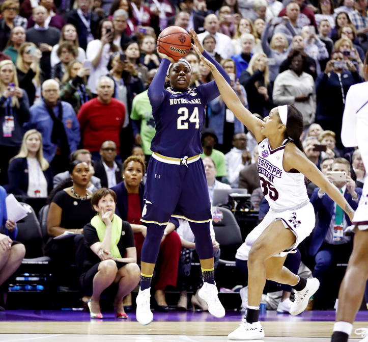Slide 4 of 97: Arike Ogunbowale (24) of Notre Dame hits the game winning shot with 0.1 seconds remaining in the fourth quarter under pressure from Victoria Vivians (35) to defeat Mississippi State 61-58 in the championship game of the 2018 NCAA Women's Final Four on April 1, in Columbus, Ohio.