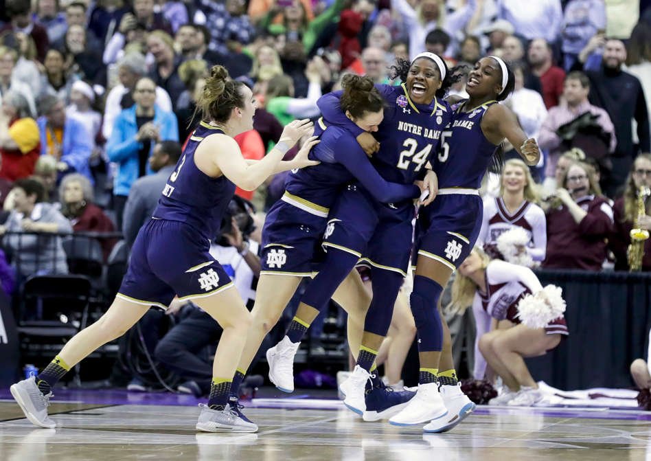 Slide 2 of 97: Members of Notre Dame, from left to right, Marina Mabrey, Kathryn Westbeld, Arike Ogunbowale and Jackie Young celebrate after defeating Mississippi State in the final of the women's NCAA Final Four college basketball tournament, on April 1, in Columbus, Ohio. Notre Dame won 61-58.