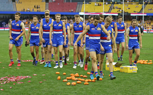 Slide 1 of 42: MELBOURNE, AUSTRALIA - APRIL 01:  The Bulldogs leave the field through easter eggs on the ground after losing the round two AFL match between the Western Bulldogs and the West Coast Eagles at Etihad Stadium on April 1, 2018 in Melbourne, Australia.  (Photo by Scott Barbour/Getty Images)