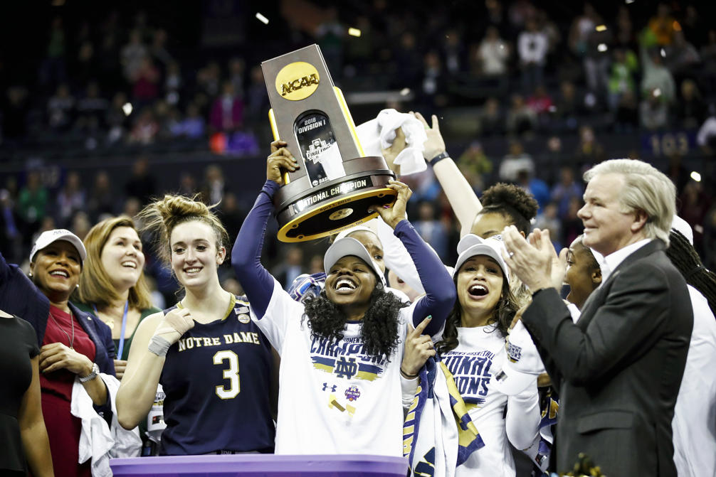 Slide 1 of 97: Arike Ogunbowale (24) of Notre Dame hoist the NCAA championship trophy after scoring the game winning basket to defeat Mississippi State in the championship game of the 2018 NCAA Women's Final Four on April 1, in Columbus, Ohio. The Fighting Irish defeated the Lady Bulldogs 61-58.