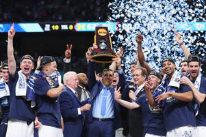 SAN ANTONIO, TX - APRIL 02:  Head coach Jay Wright of the Villanova Wildcats raises the trophy with his team after defeating the Michigan Wolverines during the 2018 NCAA Men's Final Four National Championship game at the Alamodome on April 2, 2018 in San Antonio, Texas.  Villanova defeated Michigan 79-62.