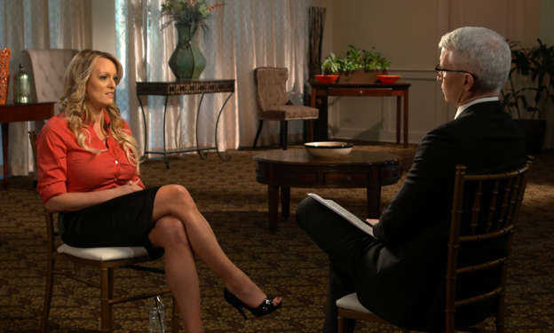 "This image released by CBS News shows Stormy Daniels, left, during an interview with Anderson Cooper which aired on Sunday, March 25, 2018, on ""60 Minutes."""