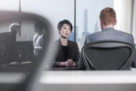 Slide 1 of 36: Woman talking in an office.