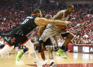 Apr 18, 2018; Houston, TX, USA; Houston Rockets guard Eric Gordon (10) attempts to strip the ball from Minnesota Timberwolves forward Andrew Wiggins (22) during the first quarter in game two of the first round of the 2018 NBA Playoffs at Toyota Center.