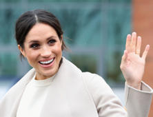 The fiancee of Britain's Prince Harry, Meghan Markle, reacts after a visit to a science park called Catalyst Inc., in Belfast, Northern Ireland March 23, 2018.