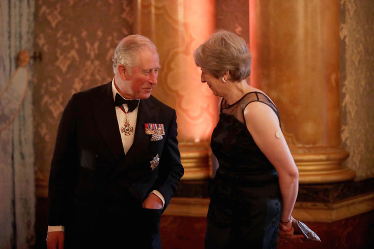 Britain's Prince Charles speaks to Britain's Prime Minister Theresa May before taking part in a receiving line at the Queen's Dinner for the Commonwealth Heads of Government Meeting at Buckingham Palace in London