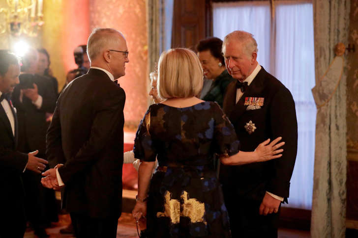 Britain's Prince Charles greets Australian Prime Minister Malcolm Turnbull and his wife Lucy in a receiving line for the Queen's Dinner for the Commonwealth Heads of Government Meeting at Buckingham Palace in London