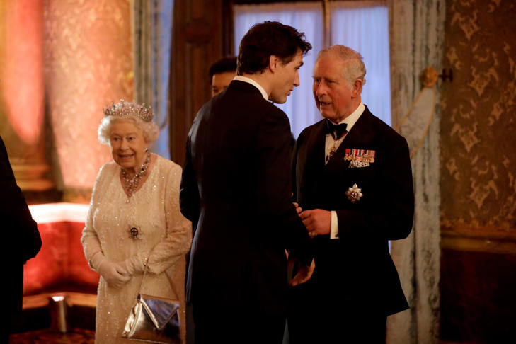 Britain's Prince Charles greets Canadian Prime Minister Justin Trudeau beside Queen Elizabeth II in a receiving line for the Queen's Dinner for the Commonwealth Heads of Government Meeting (CHOGM) at Buckingham Palace in London, Thursday, April 19, 2018. (AP Photo/Matt Dunham, Pool)