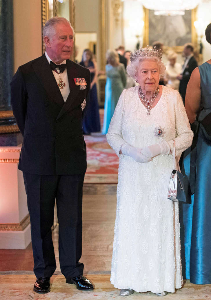 Britain's Queen Elizabeth and Prince Charles pose in the Blue Drawing Room at Buckingham Palace as the Queen hosts a dinner during the Commonwealth Heads of Government Meeting in London