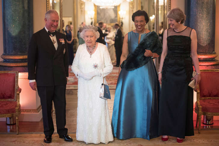 Britain's Queen Elizabeth, Prince Charles, Commonwealth Secretary-General Patricia Scotland and Prime Minister Theresa May pose in the Blue Drawing Room at Buckingham Palace as the Queen hosts a dinner during the Commonwealth Heads of Government Meeting in London, Britain April 19, 2018. Pool/Victoria Jones/via REUTERS
