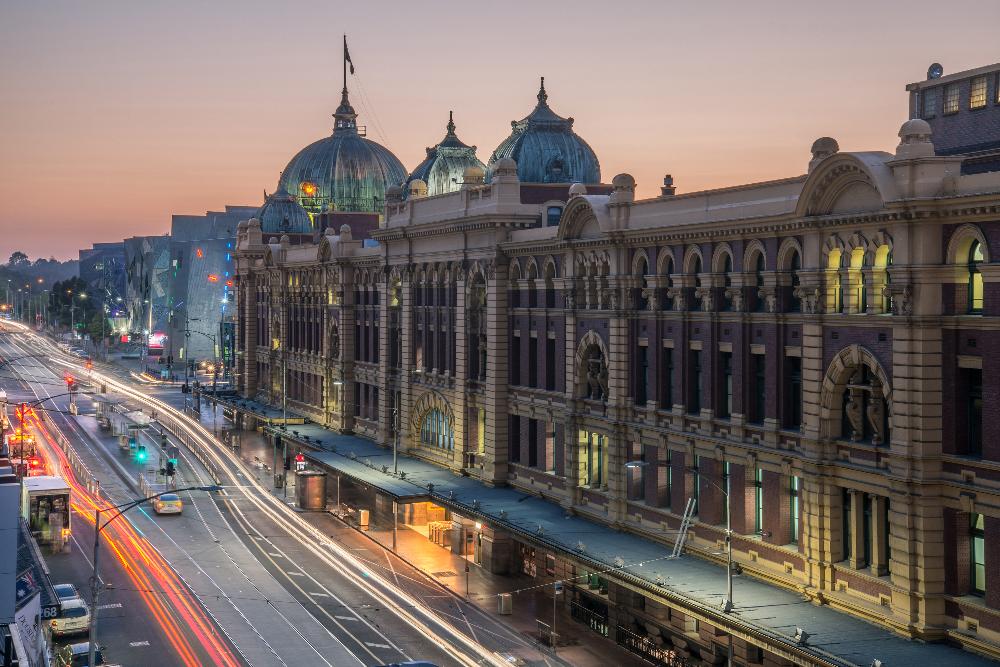 Slide 17 of 29: Melbourne, AUSTRALIA - OCTOBER 22 2015: Flinders street station the iconic landmark of Melbourne in the morning time, Australia.; Shutterstock ID 322885631; Purchase Order: -