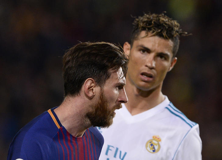 Real Madrid's Portuguese forward Cristiano Ronaldo (R) looks at Barcelona's Argentinian forward Lionel Messi during the Spanish league football match between FC Barcelona and Real Madrid CF at the Camp Nou stadium in Barcelona on May 6, 2018. (Photo by Josep LAGO / AFP)        (Photo credit should read JOSEP LAGO/AFP/Getty Images)