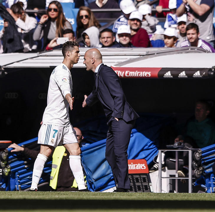 8th April 2018, Santiago Bernabeu, Madrid, Spain; La Liga football, Real Madrid versus Atletico Madrid; Cristiano Ronaldo (Real Madrid) low fives to Zinedine Zidane Coach of Real Madrid (Photo by Shot for Press/Action Plus via Getty Images)