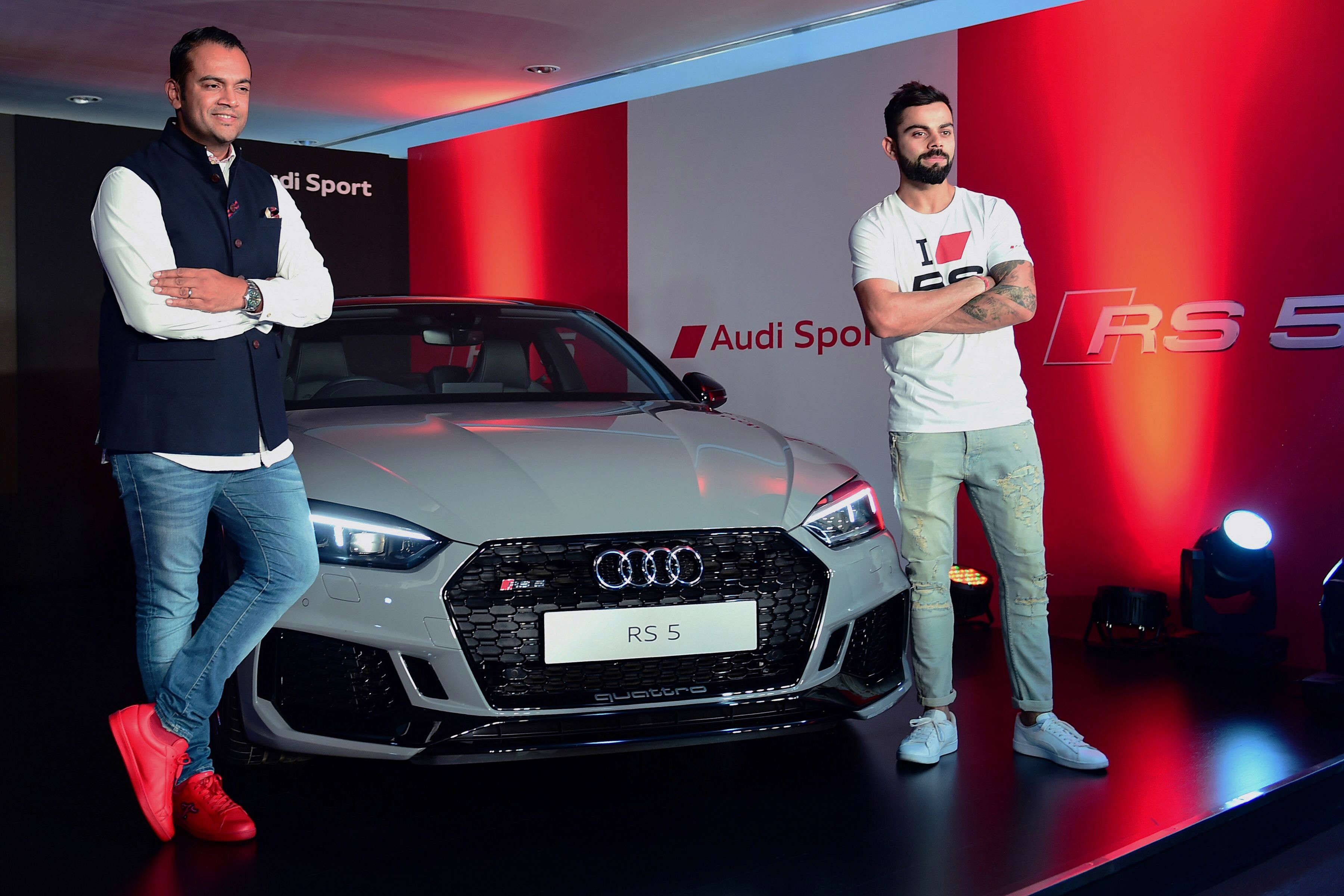 Slide 32 of 35: Indian cricket captain Virat Kohli (R) poses for a picture during a launch event for the Audi R5 coupe car. Virat recently added the mean machine to his garage.