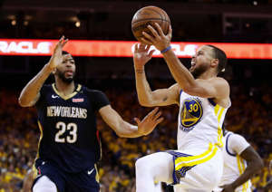 OAKLAND, CA - MAY 08:  Stephen Curry #30 of the Golden State Warriors goes up for a shot on Anthony Davis #23 of the New Orleans Pelicans during Game Five of the Western Conference Semifinals of the 2018 NBA Playoffs at ORACLE Arena on May 8, 2018 in Oakland, California.  NOTE TO USER: User expressly acknowledges and agrees that, by downloading and or using this photograph, User is consenting to the terms and conditions of the Getty Images License Agreement.  (Photo by Ezra Shaw/Getty Images)