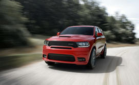 a red car going down the road: Dodge Durango GT Rallye: Look the Part, Spare the Heart