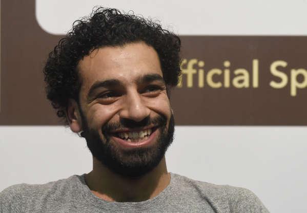 Slide 3 of 7: Mo Salah smiling