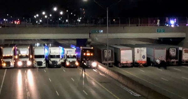 A man tried to jump off a Detroit overpass. Then 13 truckers saved him.