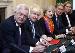 Britain's Prime Minister Theresa May, center, sits in the cabinet room of 10 Downing Street, London with David Davies Secretary of State for Exiting the European Union, left, Foreign Secretary Boris Johnson, second left, Chancellor of the Exchequer Philip Hammond and Home Secretary Amber Rudd, right, on Monday Nov. 28, 2016. (Peter Nicholls/Pool via AP)