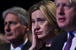 Britain's Home Secretary Amber Rudd (C) listens to the speech by Britain's Prime Minister Theresa May on the final day of the Conservative Party annual conference at the Manchester Central Convention Centre in Manchester, northwest England, on October 4, 2017. / AFP PHOTO / Oli SCARFF        (Photo credit should read OLI SCARFF/AFP/Getty Images)