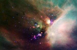 "Newborn stars peek out from beneath their natal blanket of dust in this dynamic image of the Rho Ophiuchi dark cloud from NASA's Spitzer Space Telescope. Called ""Rho Oph"" by astronomers, it's one of the closest star-forming regions to our own solar system. Located near the constellations Scorpius and Ophiuchus, the nebula is about 407 light years away from Earth."