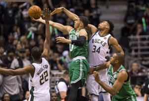 Apr 26, 2018; Milwaukee, WI, USA; Boston Celtics forward Jayson Tatum (0) shoots against Milwaukee Bucks forward Giannis Antetokounmpo (34) during the third quarter in game six of the first round of the 2018 NBA Playoffs at BMO Harris Bradley Center.