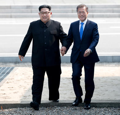 Slide 1 de 30: Mandatory Credit: Photo by KOREA SUMMIT PRESS POOL/POOL/EPA-EFE/REX/Shutterstock (9643883k) Moon Jae-in and Kim Jong-un Inter-Korean summit between heads of state of South and North Korea in Panmunjom, Paju - 27 Apr 2018 South Korean President Moon Jae-in (R) and North Korean leader Kim Jong-un (L) hold hands while walking at the military demarcation line (MDL) at the Joint Security Area (JSA) on the Demilitarized Zone (DMZ) in the border village of Panmunjom in Paju, South Korea, 27 April 2018. South Korean President Moon Jae-in and North Korean leader Kim Jong-un are meeting at the Peace House in Panmunjom for an inter-Korean summit. The event marks the first time a North Korean leader has crossed the border into South Korea sine the end of hostilities during the Korean War.