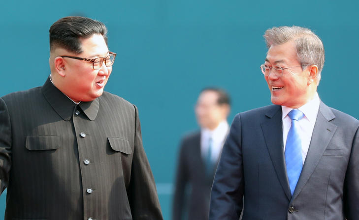 North Korean leader Kim Jong Un (L) and South Korean President Moon Jae-in (R) shake hands after Kim crossing the military demarcation line for the Inter-Korean Summit April 27, 2018 in Panmunjom, South Korea.