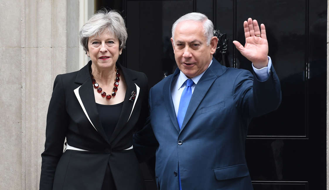 Britain's Prime Minister Theresa May greets the Prime Minister of Israel Benjamin Netanyahu in Downing Street on November 2, 2017 in London.