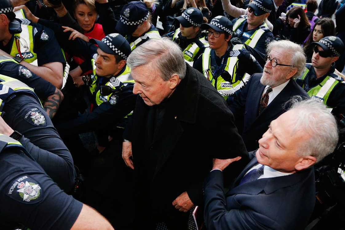 MELBOURNE, AUSTRALIA - JULY 26:  Cardinal George Pell walks with a heavy Police guard to the Melbourne Magistrates' Court on July 26, 2017 in Melbourne, Australia. Cardinal Pell was charged on summons by Victoria Police at Melbourne Magistrates' Court on July 26, 2017 in Melbourne, Australia. Cardinal George Pell was charged on summons by Victoria Police on 29 June over multiple allegations of sexual assault. Cardinal George Pell is Australia's highest ranking Catholic and the third most senior Catholic at the Vatican, where he was responsible for the church's finances. Cardinal George Pell has leave from his Vatican position while he defends the charges.  (Photo by Michael Dodge/Getty Images)
