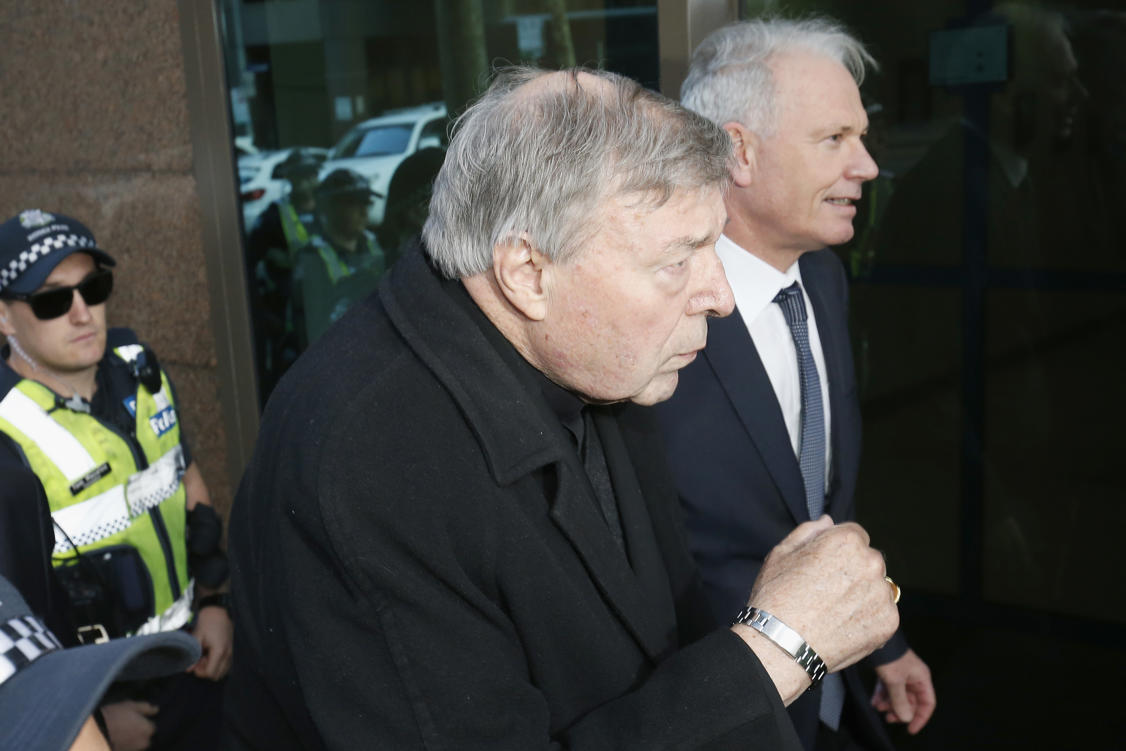 MELBOURNE, AUSTRALIA - JULY 26:  Cardinal Pell walks with a heavy Police guard to the Melbourne Magistrates' Court on July 26, 2017 in Melbourne, Australia. Cardinal Pell was charged on summons by Victoria Police on 29 June over multiple allegations of sexual assault. Cardinal Pell is Australia's highest ranking Catholic and the third most senior Catholic at the Vatican, where he was responsible for the church's finances. Cardinal Pell has leave from his Vatican position while he defends the charges.  (Photo by Darrian Traynor/Getty Images)