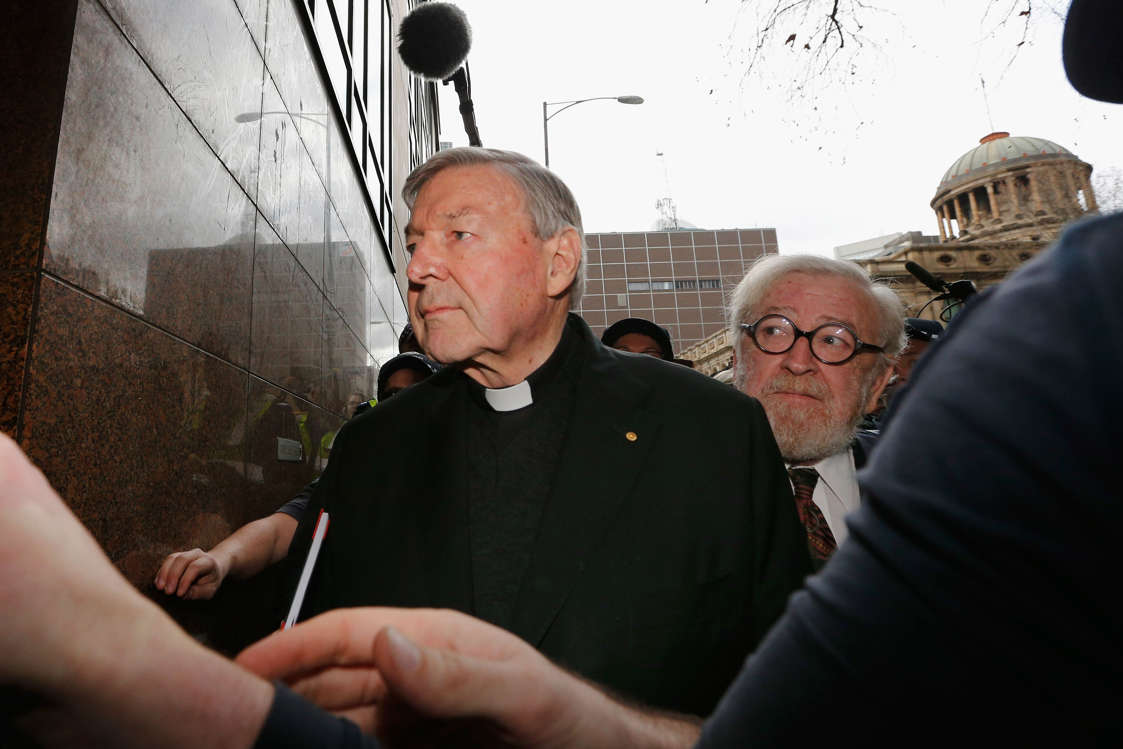 MELBOURNE, AUSTRALIA - JULY 26:  Cardinal George Pell walks with a heavy Police guard from the Melbourne Magistrates' Court on July 26, 2017 in Melbourne, Australia. Cardinal Pell was charged on summons by Victoria Police at Melbourne Magistrates' Court on July 26, 2017 in Melbourne, Australia. Cardinal George Pell was charged on summons by Victoria Police on 29 June over multiple allegations of sexual assault. Cardinal George Pell is Australia's highest ranking Catholic and the third most senior Catholic at the Vatican, where he was responsible for the church's finances. Cardinal George Pell has leave from his Vatican position while he defends the charges.  (Photo by Michael Dodge/Getty Images)