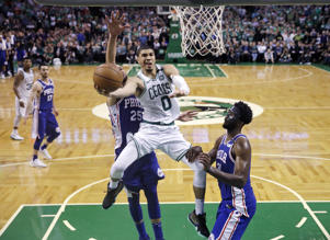 Boston Celtics forward Jayson Tatum (0) drives to the basket against the Philadelphia 76ers during the second half of Game 5 of an NBA basketball playoff series in Boston, Wednesday, May 9, 2018. Tatum scored 25 points as the Celtics defeated the 76ers 114-112.