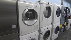 a washer and dryer in a parking lot: Washing Machine Buying Guide